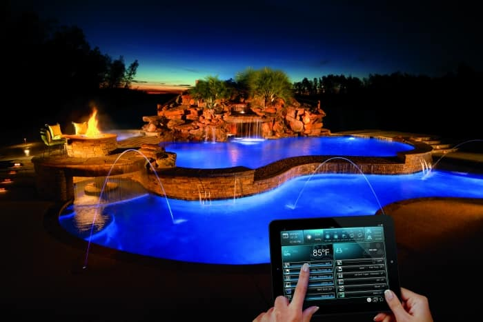 woman uses home automation panel to control swimming pool features