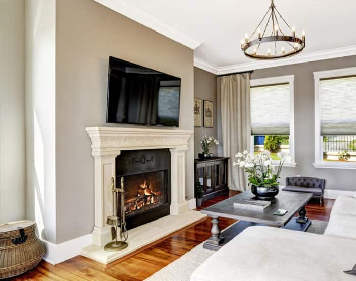 traditional fireplace mantel with TV mounted above