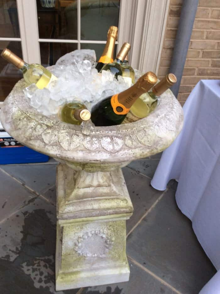 garden urn holding champagne and wine