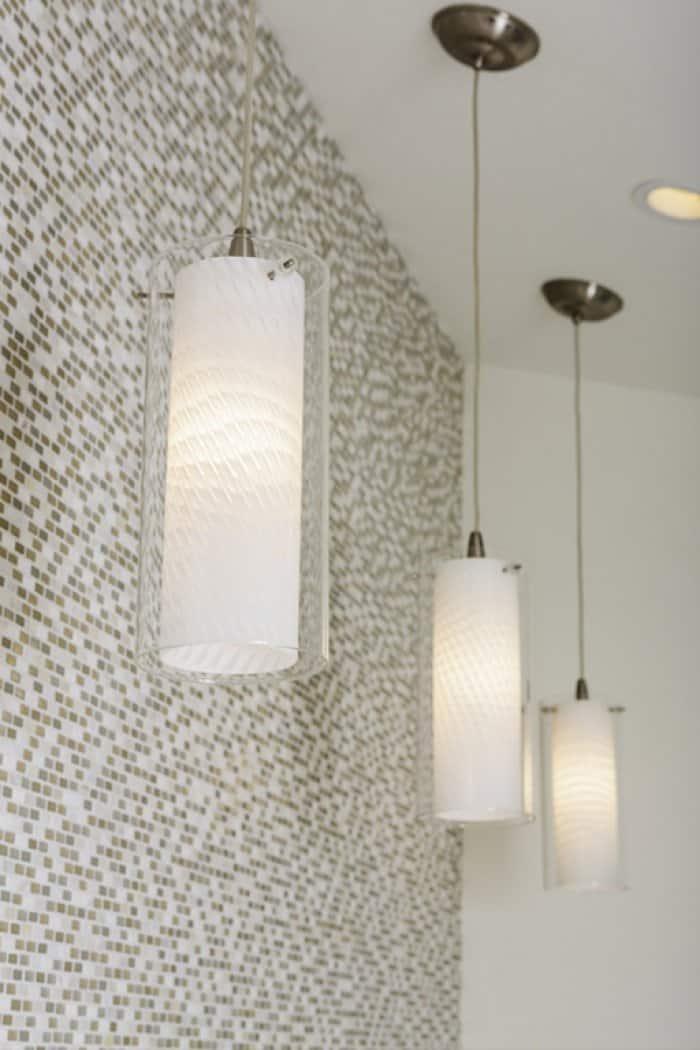 Pendant lights against tiled backdrop