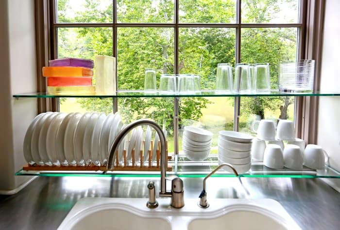 kitchen dishes above sink (Photo by Frank Espich)