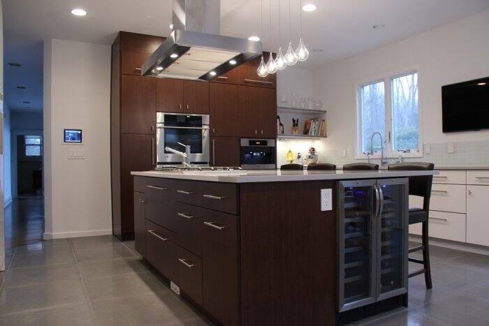 dark kitchen island with wine fridge
