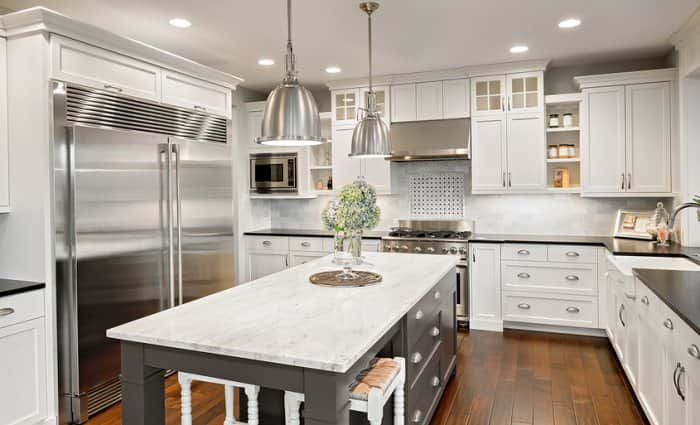 white and gray kitchen island with chrome pendant lights