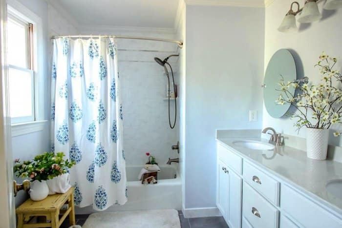 master bathroom with curved shower curtain