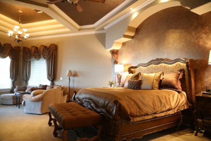 Turn your master bedroom into a master suite by adding a comfortable sitting area. (Photo by Luxury Home Solutions )