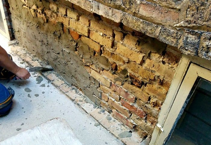 old brick wall being repointed