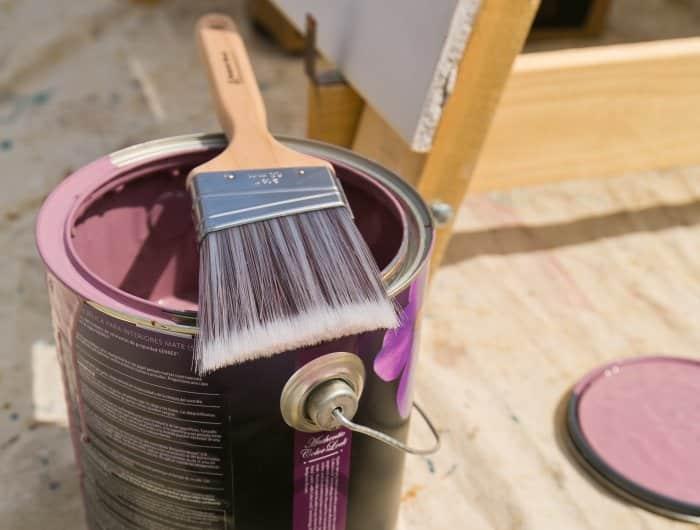 paint brush on purple paint can