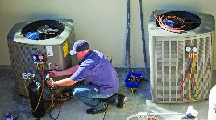 HVAC technician checking refrigerant