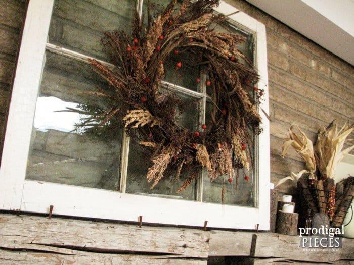 wreath framed by old window