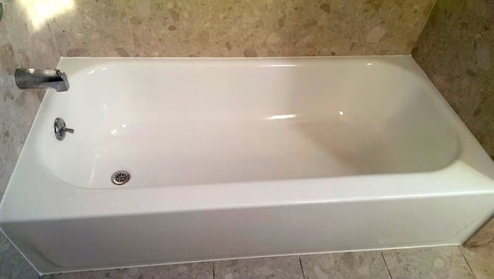 Bathtub reglazed in white