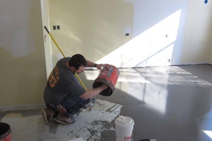Pouring self-leveler on floor