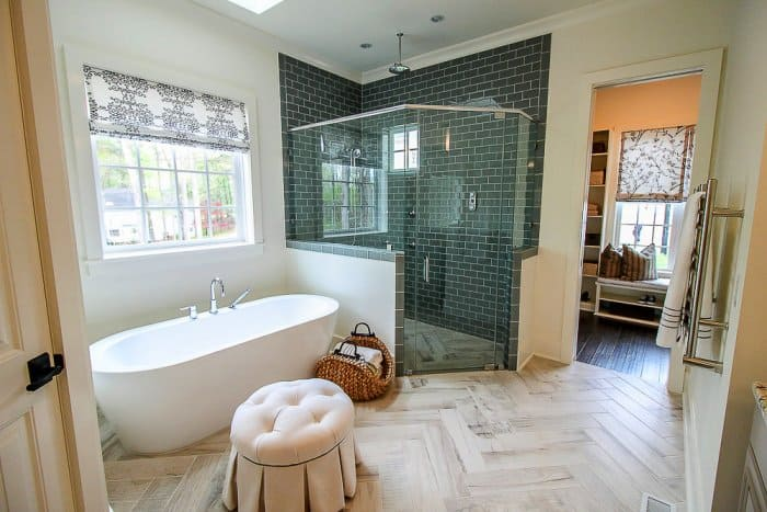 spa-like bathroom with seating and large tub