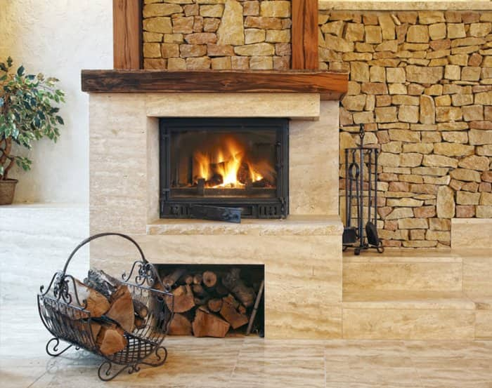combination marble and stone fireplace with firewood holder
