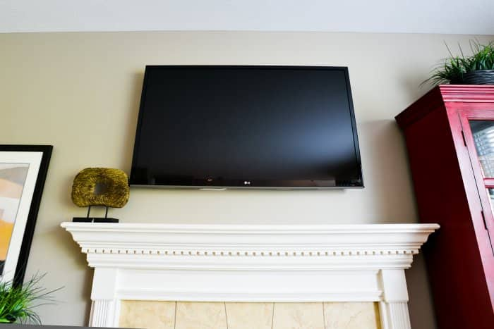tv mounted over mantel