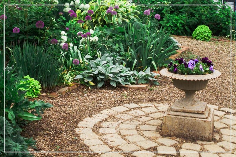 backyard garden with gravel path (Photo by Ben Ashby / iStock / Getty Images Plus via Getty Images)