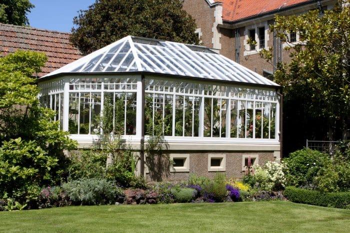 Make your greenhouse elegant with a brick base. (Photo courtesy of ngirish)