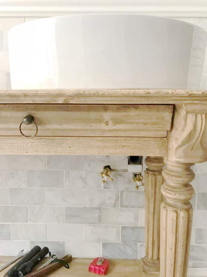 The console fit the space perfectly and would enhance the bathroom's look. (Photo courtesy of Courtney A/The French Country Cottage)