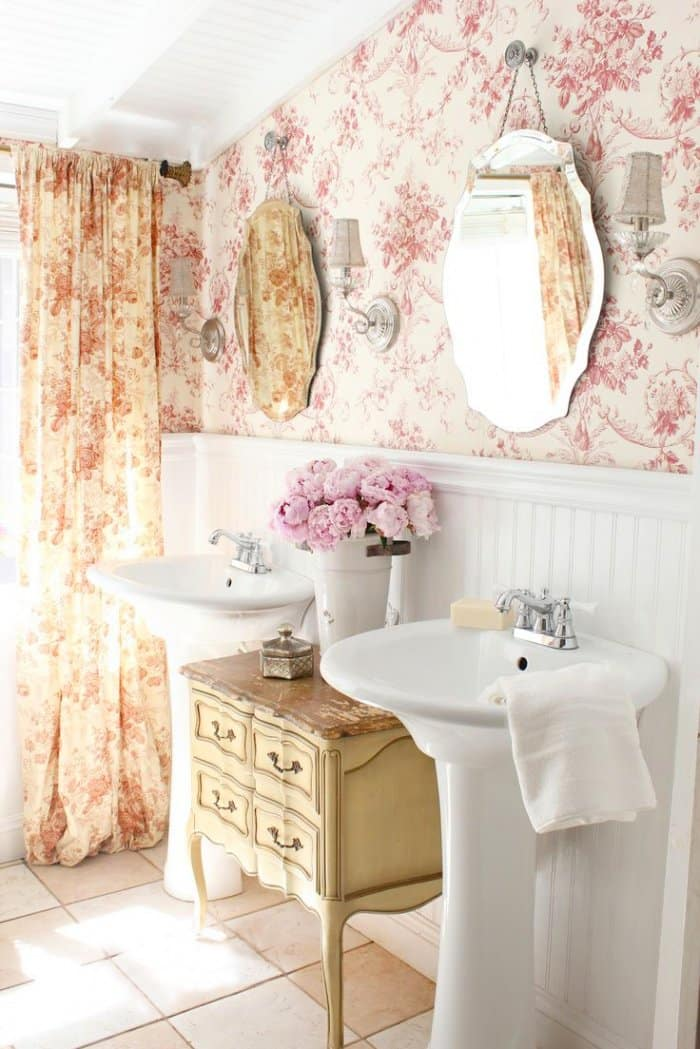 With just two pedestal sinks and a cabinet, the bathroom didn't offer as much storage as needed. (Photo courtesy of Courtney A/The French Country Cottage)