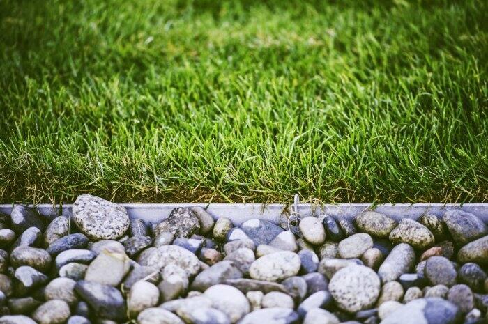Use pebbles to create a pretty garden border. (Photo courtesy of iStock Photo)