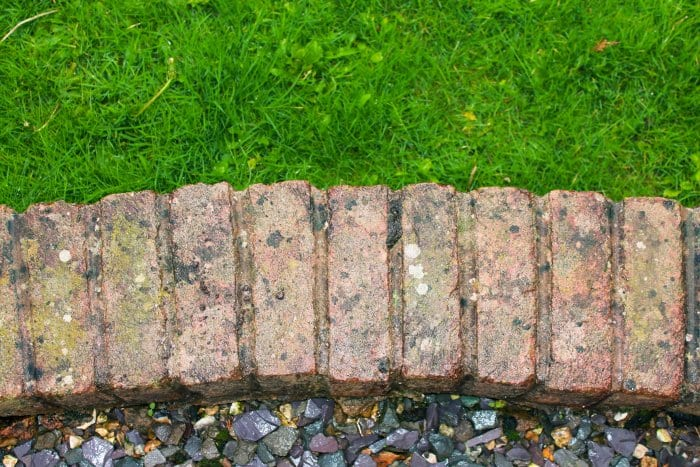 Brick is a durable option for edging. (Photo courtesy of iStock Photos/Getty Images)
