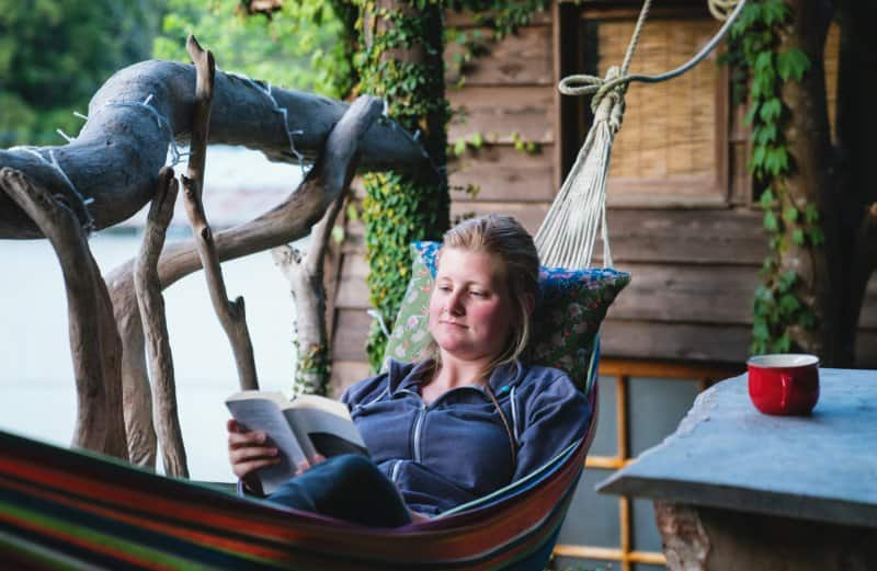 woman reading book in hammock  (Photo by tdub303/iStock/Getty Images Plus via Getty Images)