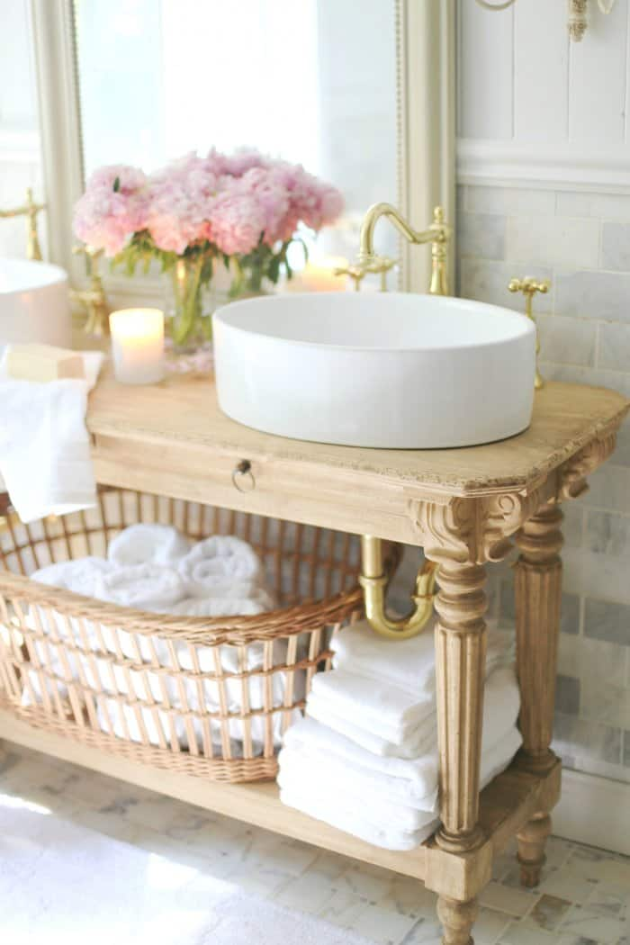Avoid breaking the bank by building your own vanity from a console. (Photo courtesy of Courtney A/The French Country Cottage)