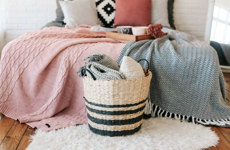 basket with blankets in bedroom  (Photo by Yuriy Kovtun/iStock/Getty Images Plus via Getty Images)