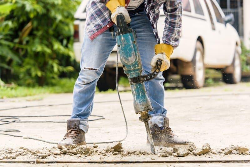 Professional demolishing concrete driveway (Photo by THANATASDcom/ iStock / Getty Images Plus via Getty Images)