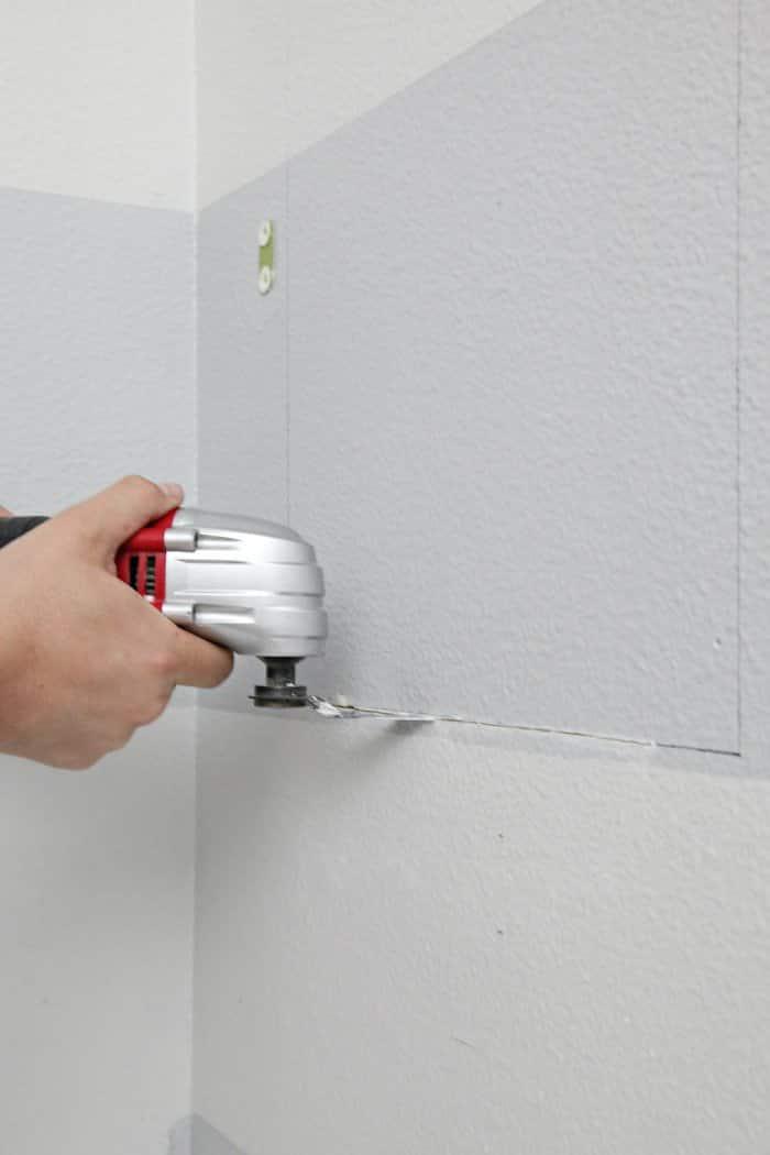 Use an oscillating tool to cut away the drywall. (Photo courtesy of Jennifer Jones/iHeart Organizing)