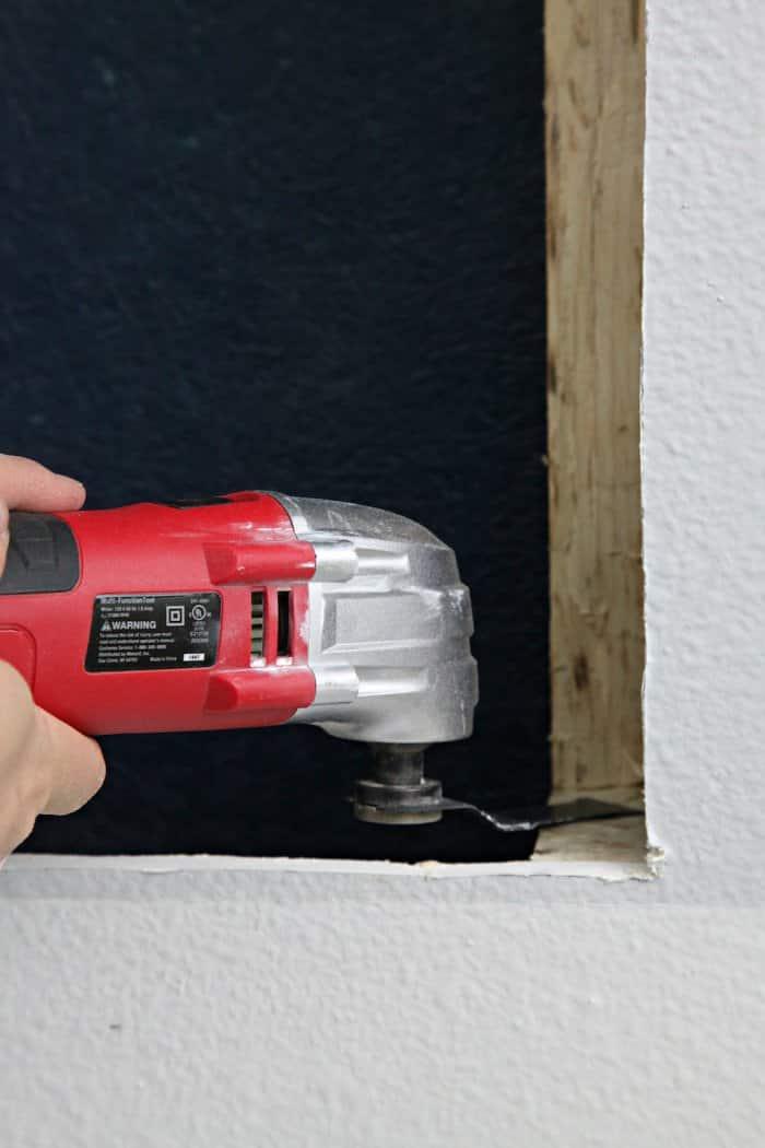 Carefully remove a portion of the wall stud. (Photo courtesy of Jennifer Jones/iHeart Organizing)