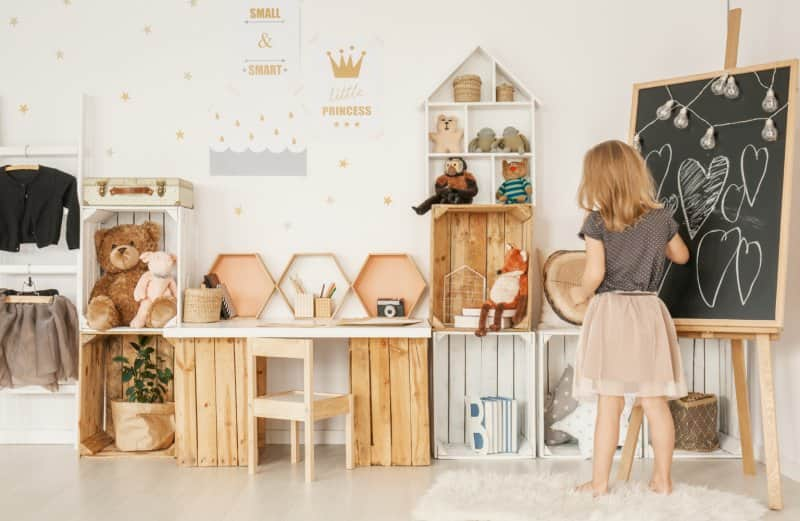 young girl in playroom  (Photo by KatarzynaBialasiewicz/iStock via Getty Images)