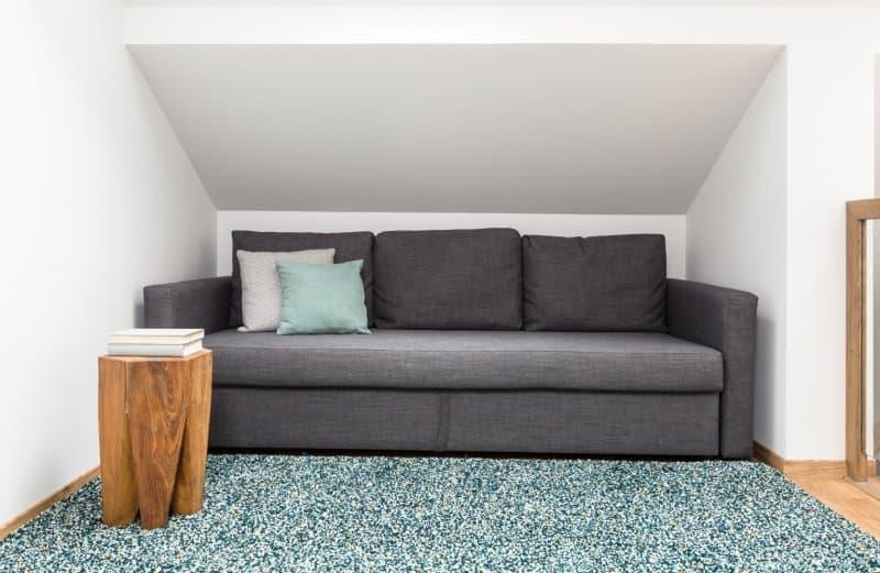 couch in storage loft  (Photo by KatarzynaBialasiewicz/iStock via Getty Images)