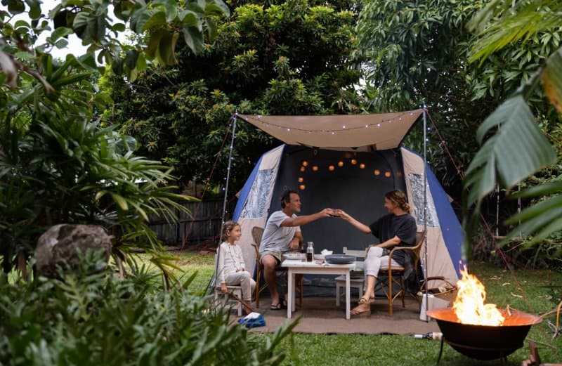 family in backyard with camping tent  (Photo by LOUISE BEAUMONT/iStock/Getty Images Plus via Getty Images)