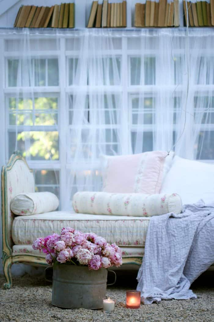 A daybed adds a vintage, pretty look. (Photo courtesy of Courtney Allison/The French Country Cottage)