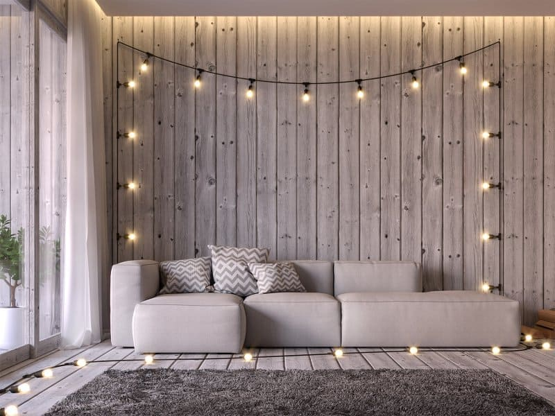 Living room with string lights (Photo by onzon - stock.adobe.com)