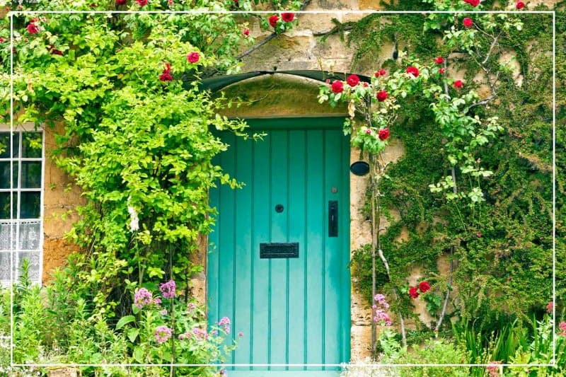aqua color front door  (Photo by YolaW/iStock/Getty Images Plus via Getty Images)