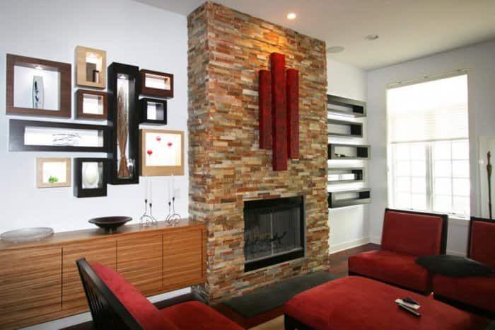 Home using accent lighting to highlight art over a fireplace