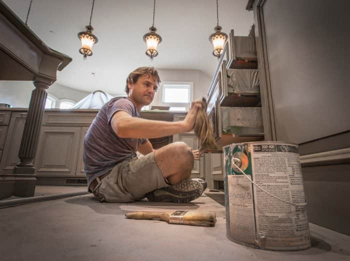 David Studley of Silver Crow Studios finishing kitchen cabinets
