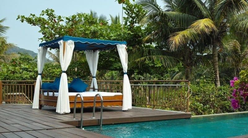 beautiful backyard cabana on pool deck (Photo by allensima - stock.adobe.com)