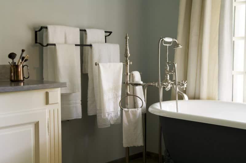 closeup of bathroom with towel racks and freestanding bathrub (Photo by  Andreas von Einsiedel/Corbis Documentary via Getty Images)