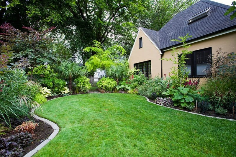 Home with beautifully landscaped yard (Photo by Mint Images/Mint Images RF via Getty Images)