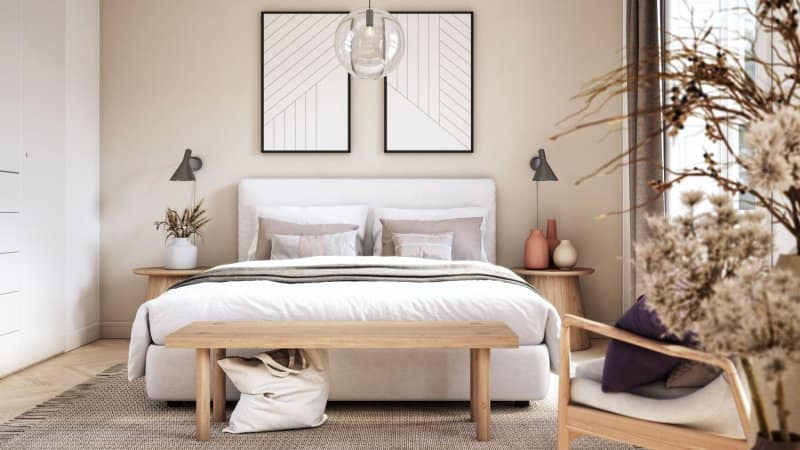 A scandinavian bedroom with beige walls (Photo by CreativaStudio/E+ via Getty Images)