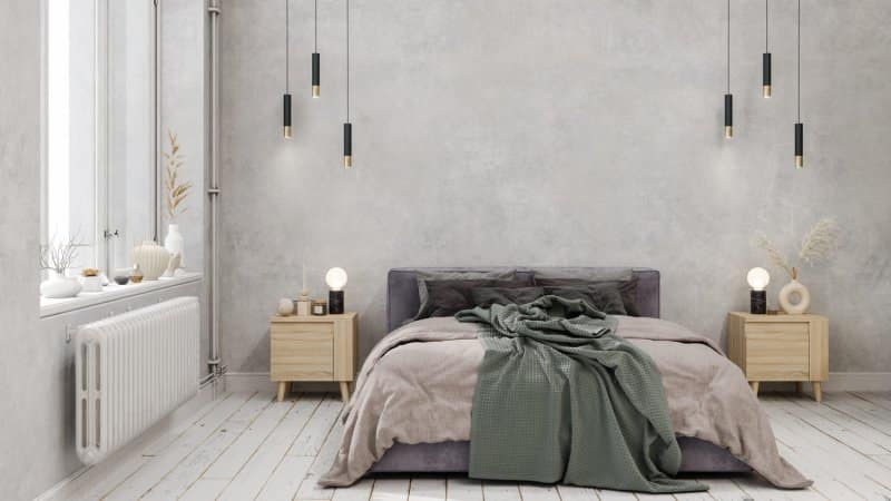 A bedroom with pendant lights and gray walls (Photo by onurdongel/E+ via Getty Images)