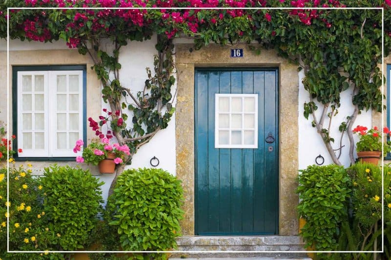 black forest green front door  (Photo by JLGutierrez/iStock/Getty Images Plus via Getty Images)
