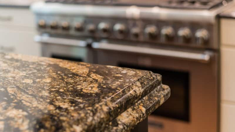 Close up of black and gold granite countertop (Photo by Kyle Santee/Shutterstock.com)