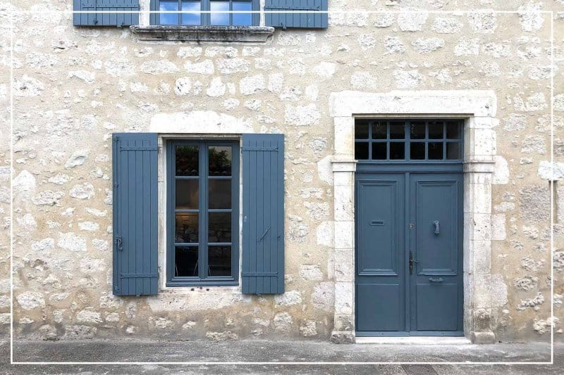 blue-gray color front door  (Photo by cmspic/iStock/Getty Images Plus via Getty Images)