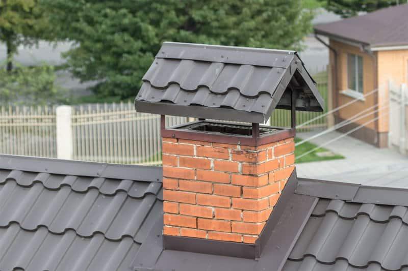 roof with chimney cap  (Photo by Larysa - stock.adobe.com)