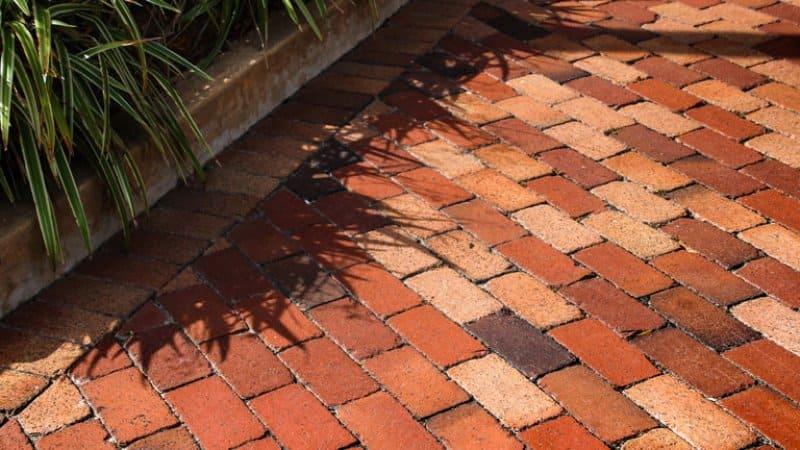 Red brick paver patio with planters