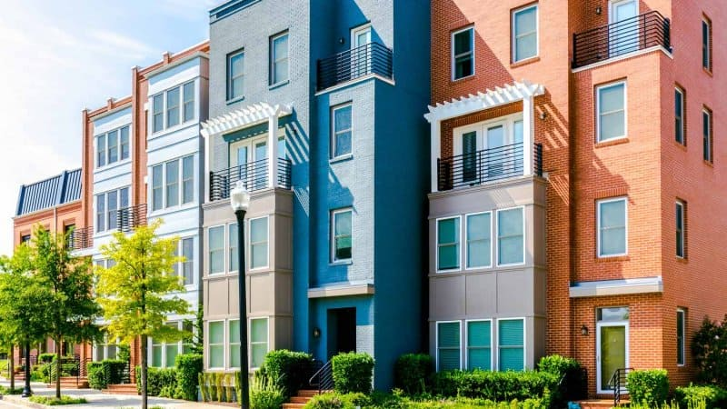 Row of brick townhouses in Alexandria, VA (Photo by Grace Cary/Moment via Getty Images)