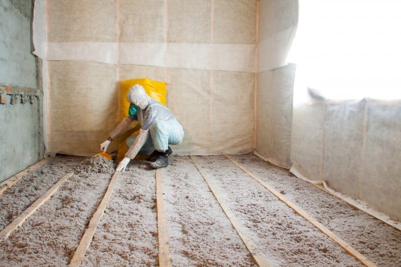 person adding cellulose insulation to floor of home (Photo by © mironovm - stock.adobe.com)